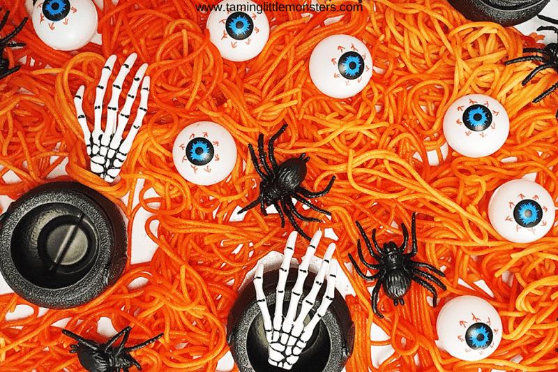 orange spaghetti halloween sensory bin