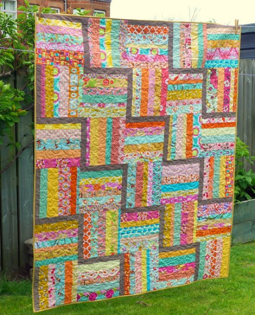 Scrappy Rail Fence Block Quilt Designed by Judith Hollies of Just Jude Designs