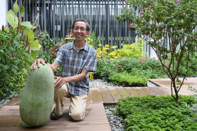 Mr. Ivan Loh, 71, with his winter melon, which at 25kg, won for being the Heaviest Winter Melon at the Community Garden Edibles Competition.