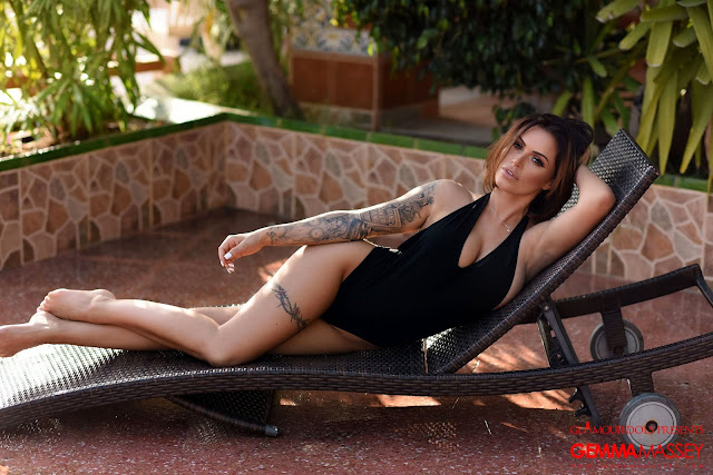 Gemma Massey  sexy side pose hand on hairs black bodysuit