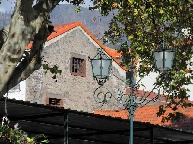 lanterns between historic buildings