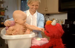 there is a baby being bathed by his mother in a small tub. Elmo explains that a baby needs water and mommy to take a bath. Sesame Street Elmo's World Bath Time Kids and Baby