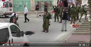 IDF-soldat gjør klar våpenet, B'tselem-video