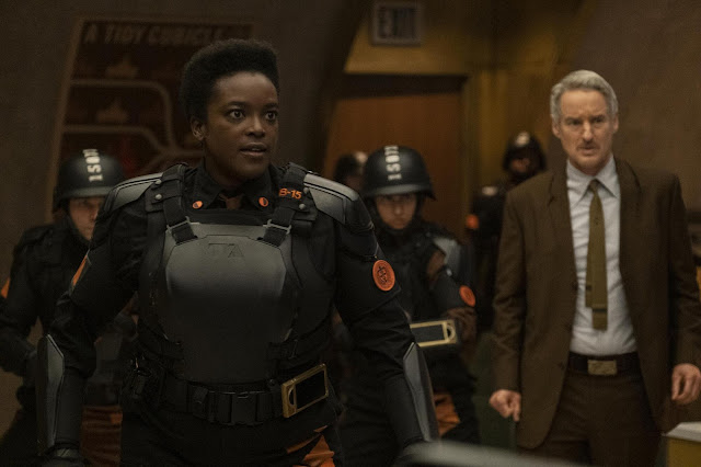A Black woman and white man face the camera in action shot.