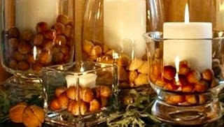 Fall vases with pinecones and candles.