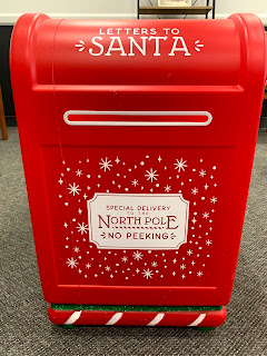 an image of a big red mailbox that says letters to the North Pole