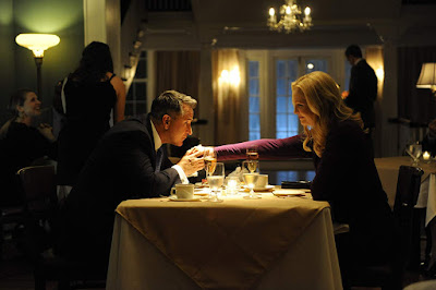 "Movie still for the 2014 thriller ""Stephen King's A Good Marriage"" where Anthony LaPaglia kisses Joan Allen's hand while they are at dinner"