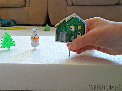 Homemade cardstock houses and snowmen for fine motor practice from And Next Comes L