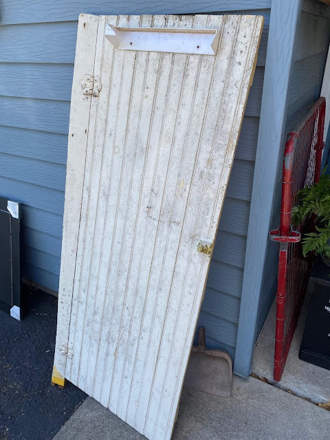 Photo of a vintage tongue & groove cabinet door