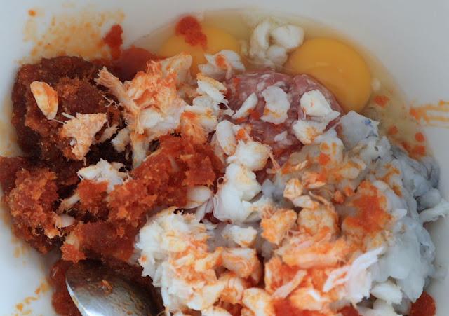 bun rieu - the rieu mixture made with crab, pork, shrimp