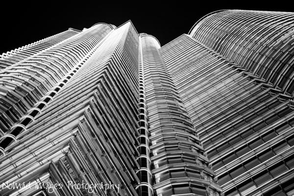 towering petronas towers at night