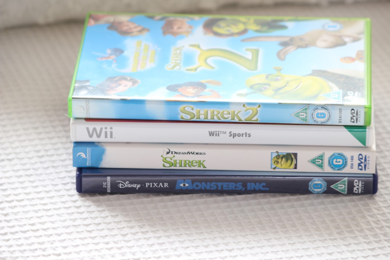 18 Things Kids From The Noughties Will Remember  DVDs video films monsters inc wii sports