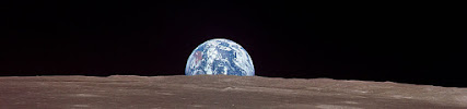 Earth rising over the Moon.