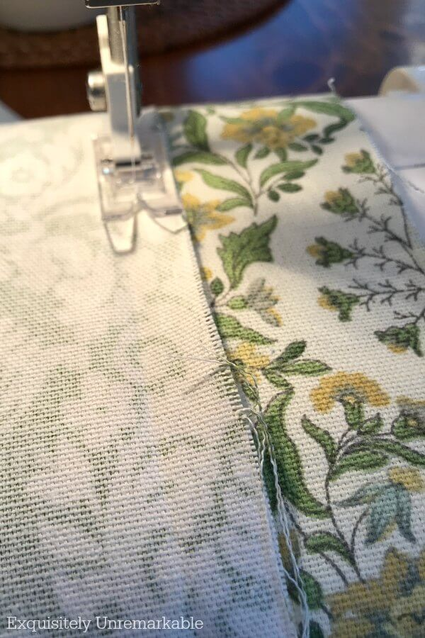 Sewing machine needed sewing a seam on a green valance