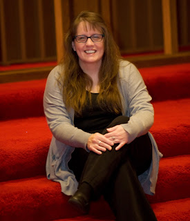 Picture of Rev Lori sitting on stairs