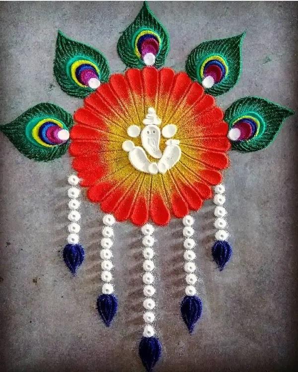 Ganesh_with_peocock_leaves_rangoli_design