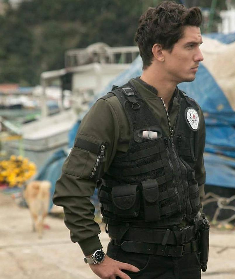 handsome-dark-haired-uniformed-masculine-young-man-police-officer-working