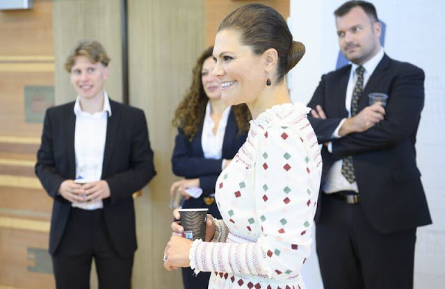 Crown Princess Victoria wore a comfy maisy dress from By Malina. Caroline Svedbom burgundy drop earrings. Rizzo Azelia pumps