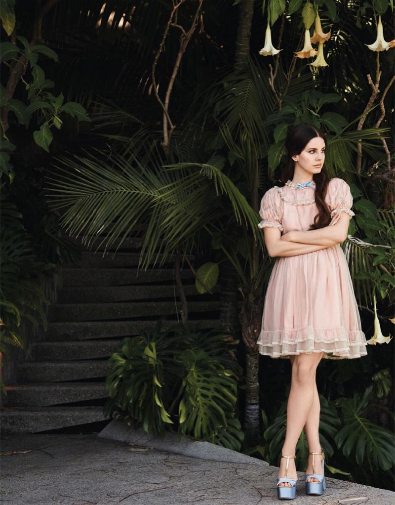 Lana Del Rey looks pretty in pink wearing a babydoll dress with puffed sleeves