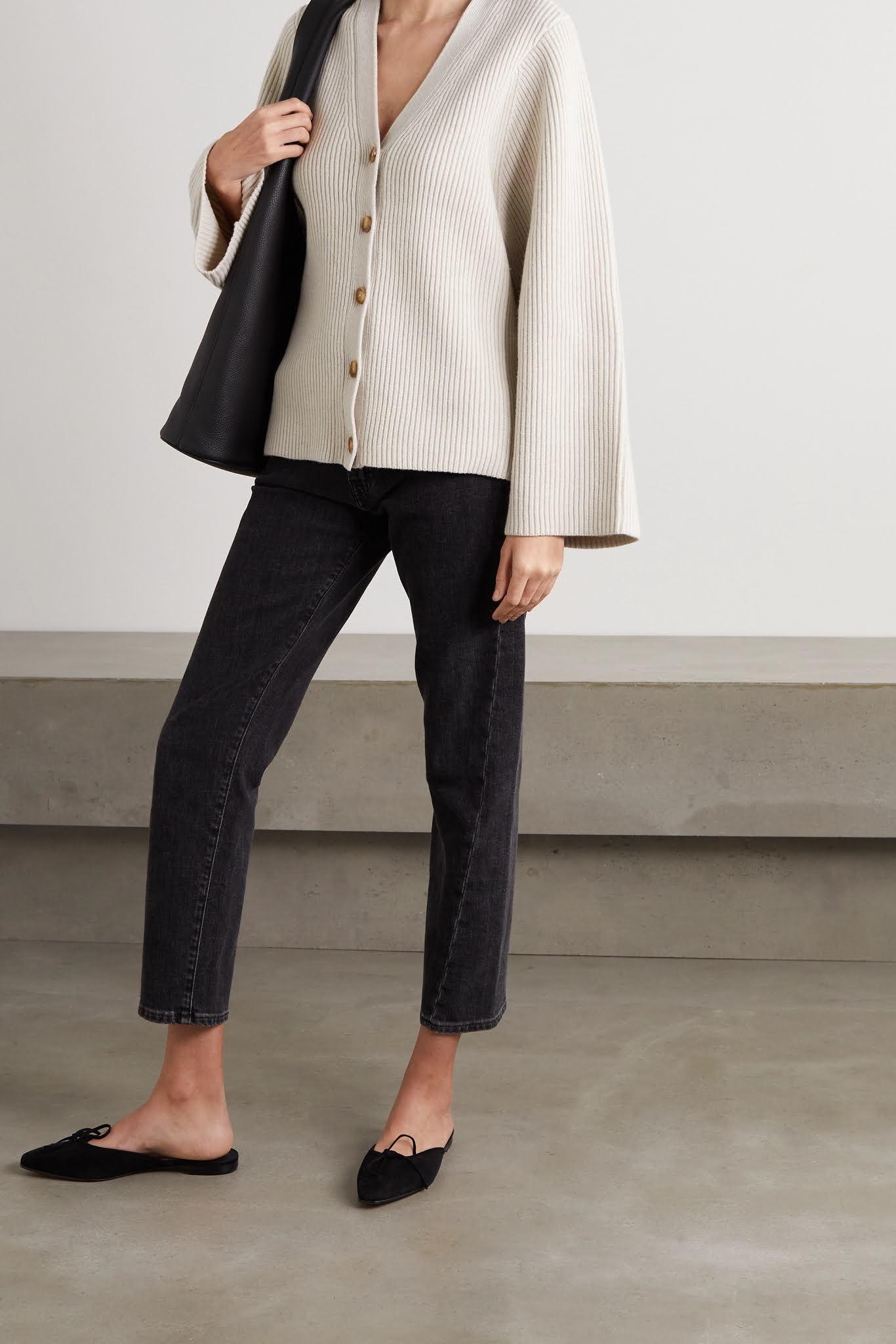 Minimalist Spring Outfit Idea — Toteme neutral cardigan sweater, faded black jeans, and Manolo Blahnik Ballerimu mule flats