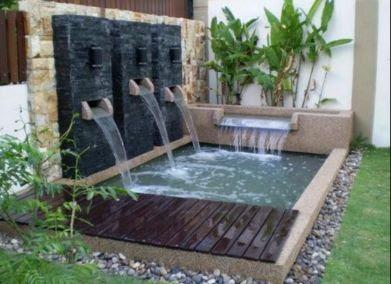 taman dengan air mancur rumah minimalis