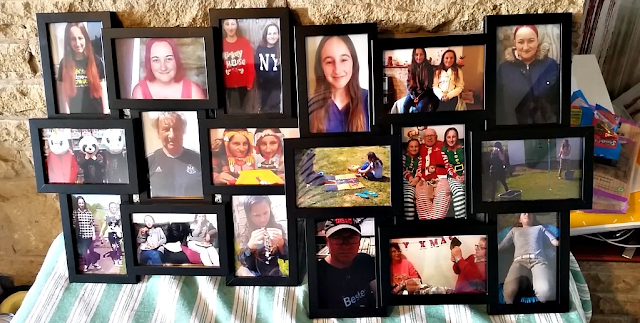 My new picture frames with family photos waiting to go up on the wall.