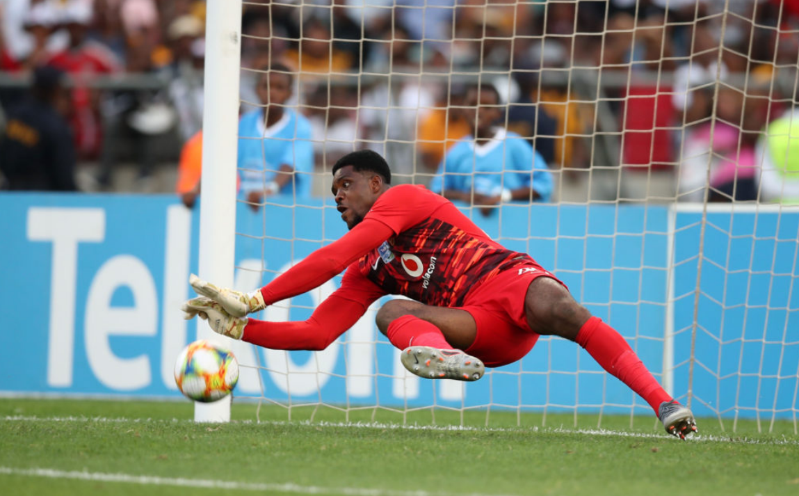 Kaizer Chiefs goalkeeper Daniel Akpeyi saving a hard and low shot