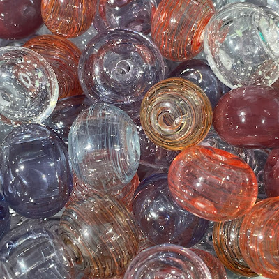 Handmade hollow lampwork glass beads made with various CiM glasses