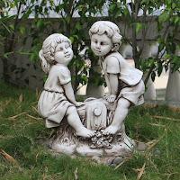 Estatuas de niños para el jardín