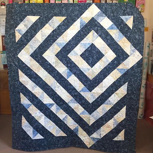 Four Patch Charm Quilt Free Pattern designed by Kathy  Schwartz Tamarack Shack Longarm Quilting Blog