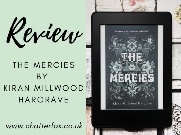 Image of the front cover of the ebook version of The Mercies by Kiran Millwood Hargrave. The book cover features the book title in bold and a floral pattern surrounding it. The ebook is displayed on a Amazon Kindle Paperwhite that is laid on a pastel coloured background that features small drawers. Alongside the image is a title that reads 'Review, The Mercies by Kiran Millwood Hargrave www.chatterfox.co.uk'