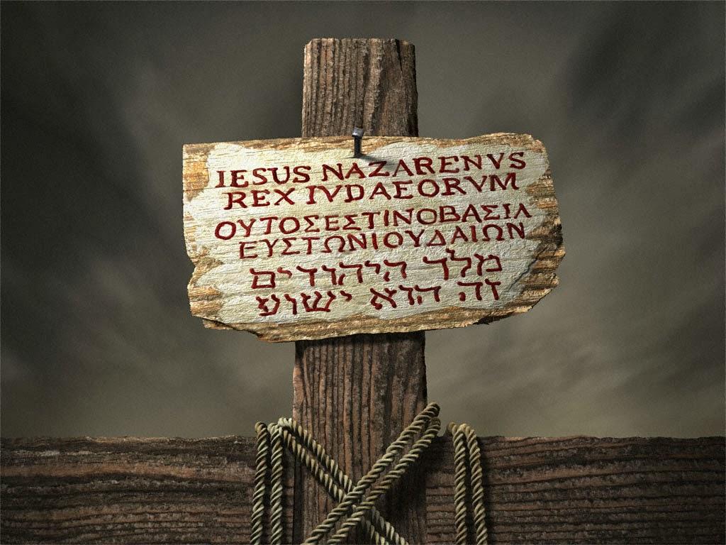 Modelo de escrita que havia na placa na cruz