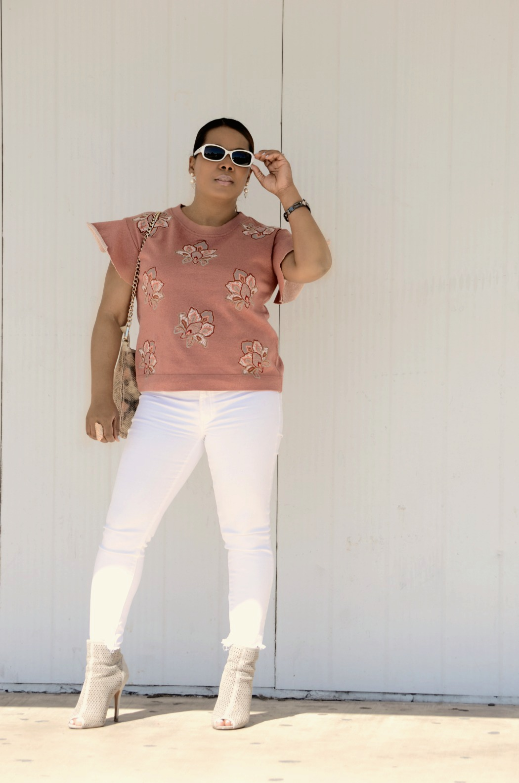 American Eagle High rise frayed skinny white jeans_Anthropologie flutter sleeve embroidered pink top_Chinese Laundry Perforated Ankkle Booties_Aldo Snakeskin Foldover Clutch