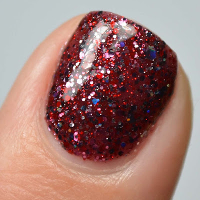 red nail polish with red and holo glitter swatch