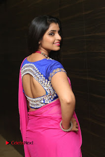 Anchor Shyamala Pictures in Pink Saree at Nandini Nursing Home Audio Launch  0015.JPG