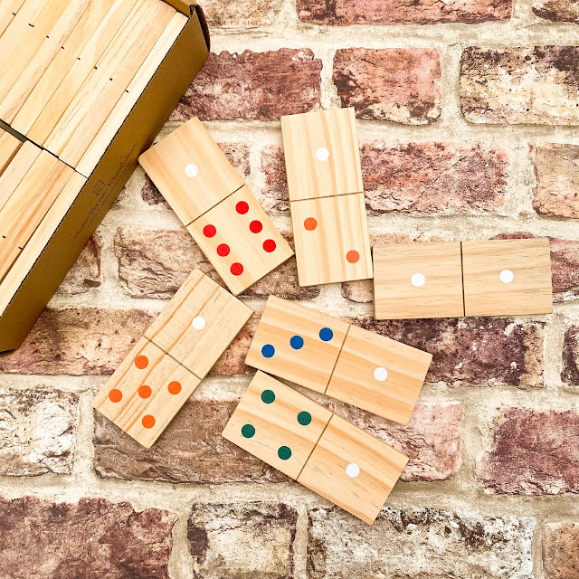 Giant wooden dominoes photographed on a flatlay