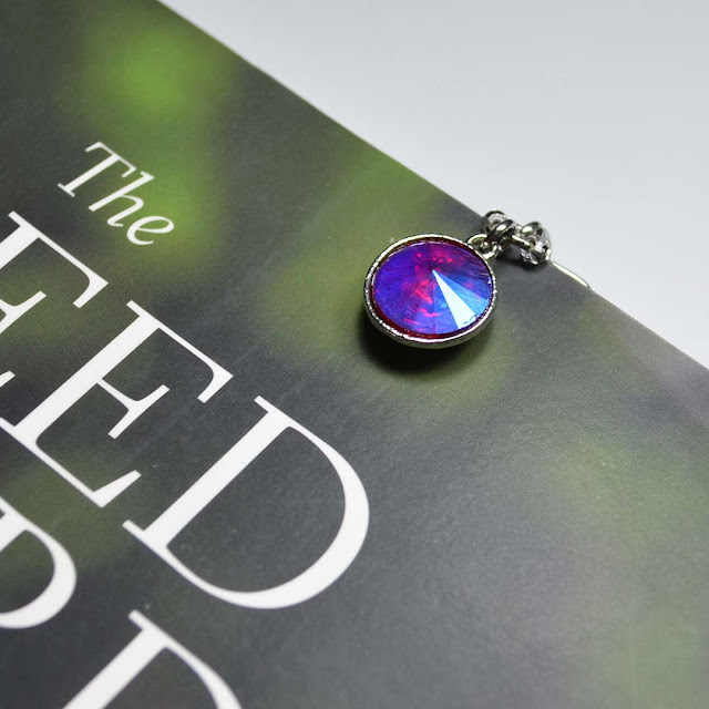 colorful gem page marker marking a page in a book