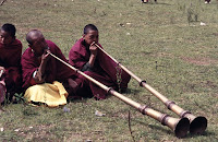 Mosuo monks on mountain horns
