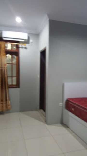 Merciful Home Stay fasilitas kamar AC