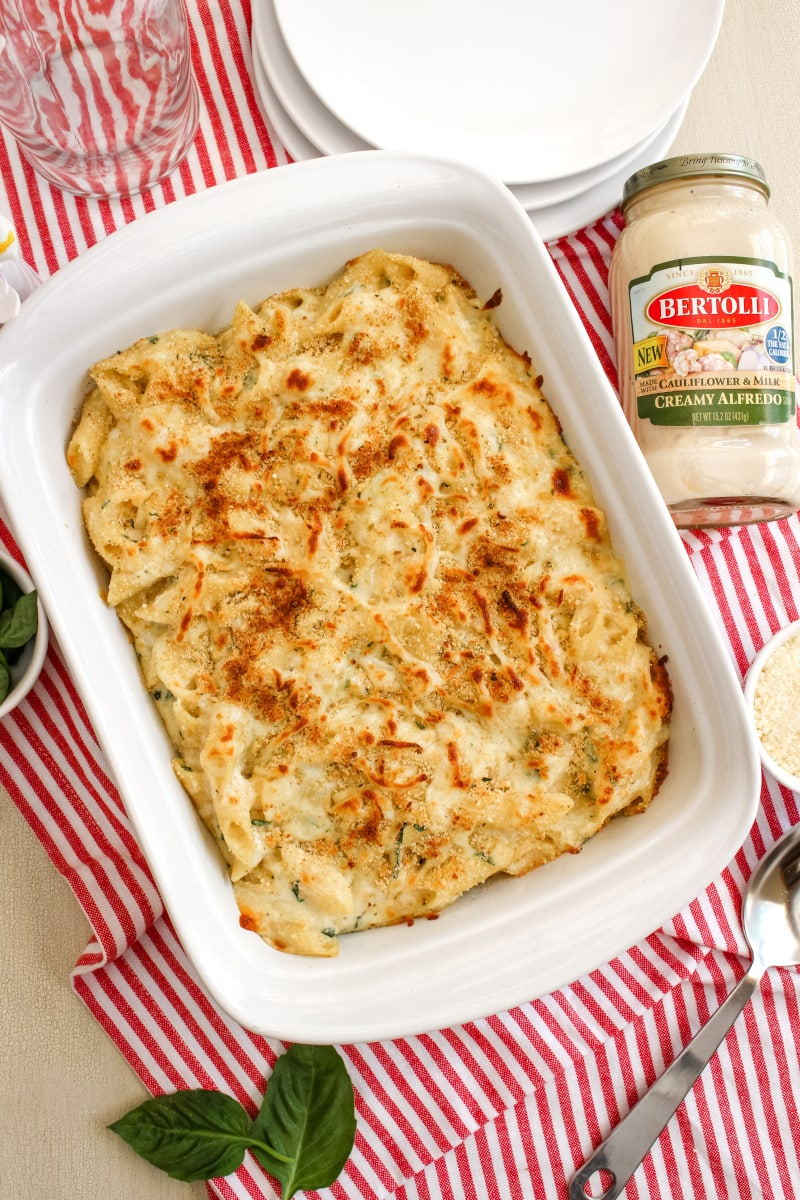 This Oven-Baked Alfredo Pennoni and Cheese made with ricotta cheese and fresh basil leaves is lightened up with a creamy cauliflower Alfredo Sauce. It's the baked alfredo dish you need in your life! #alfredosauce #macaroniandcheese #pasta #ad
