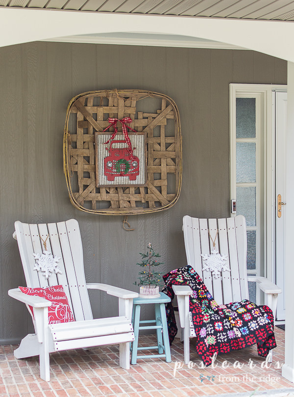 white wooden adirondack chairs and vintage tobacco basket on wall