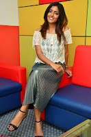 Eesha in a cute deep neck top and Skirt at at Big FM 025.JPG
