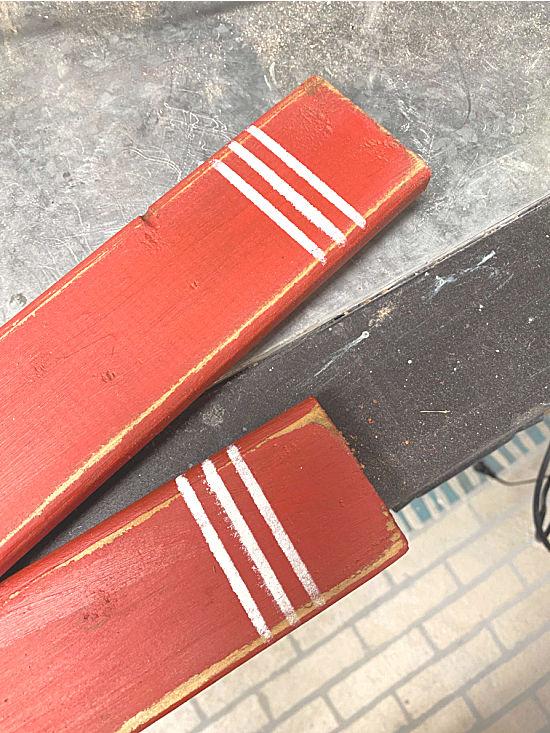 stenciled white stripes on skis