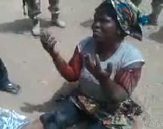 woman boko haram gun cassava bags