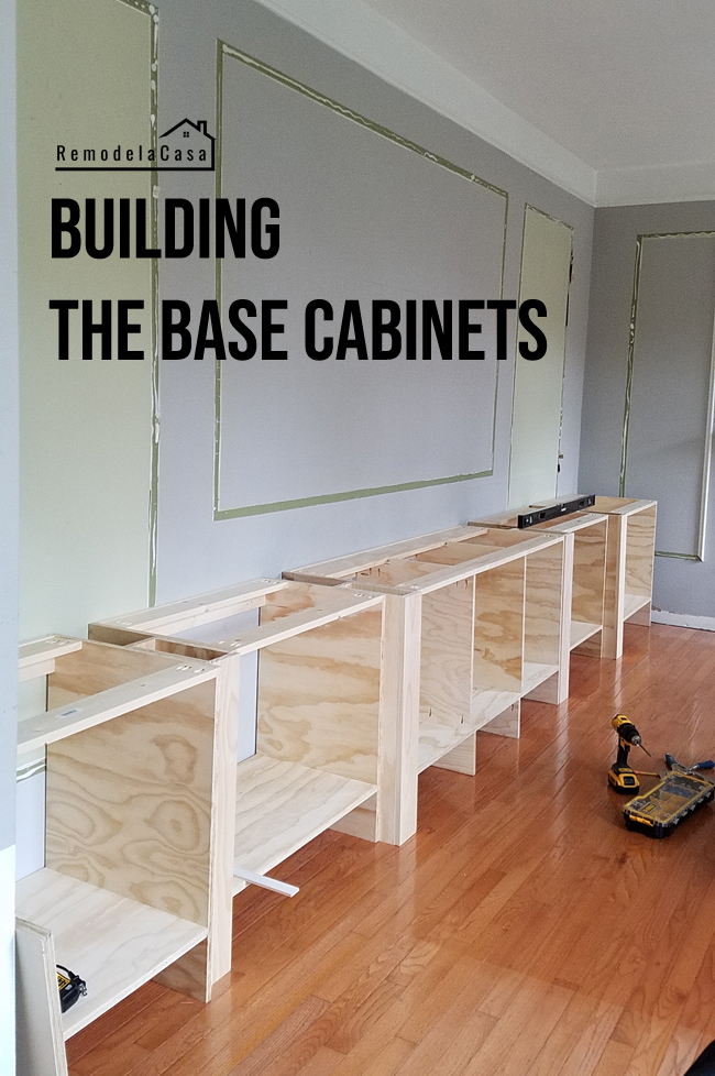 Base cabinet carcasses lining an entire wall in a family room