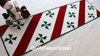 green pinwheels with red and white stripes for a table runner by QuiltFabrication