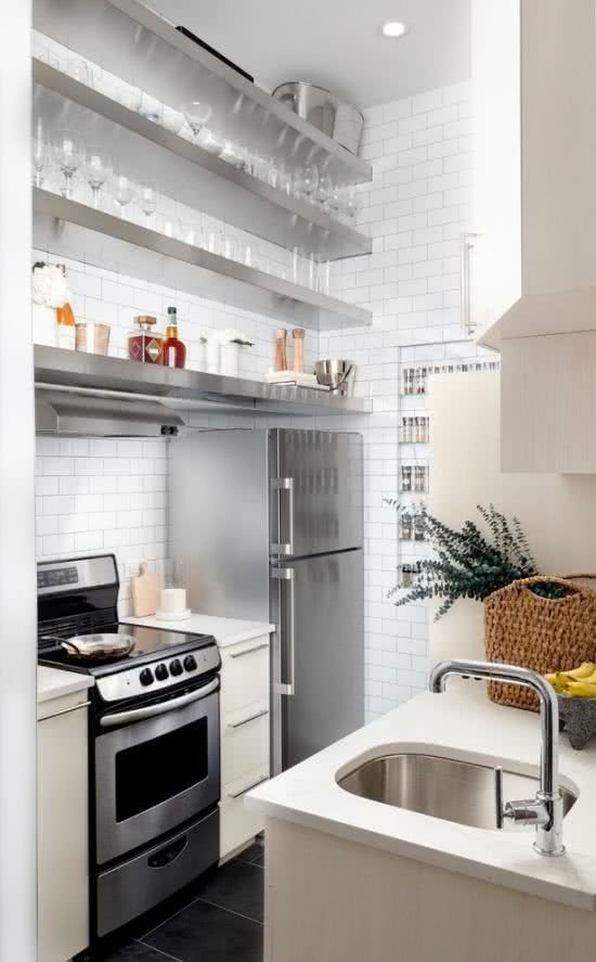 Kitchen with subway tiles and stainless steel details.