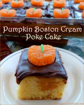 Pumpkin Boston Cream Poke Cake is a seasonal version of a classic cake. A yellow cake is infused with a silky pumpkin cream and topped with chocolate ganache. | Recipe developed by www.BakingInATornado.com | #recipe #dessert