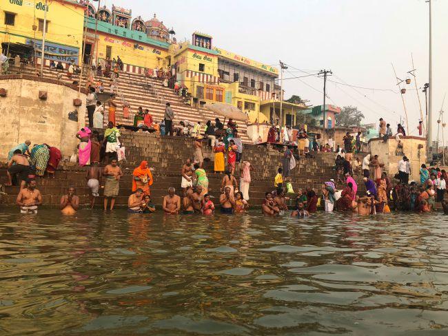 Devotees taking a dip in Holy Ganga at the Ghats of Varanasi