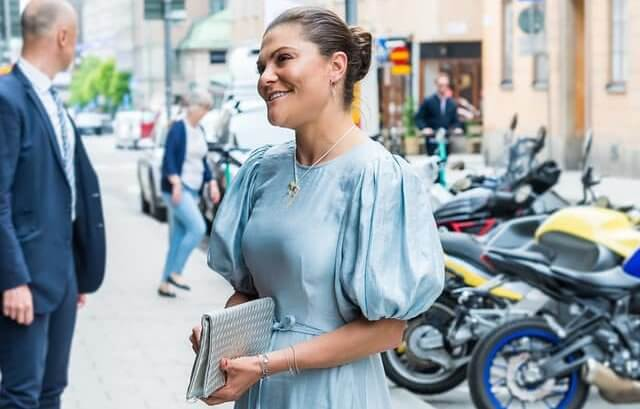Crown Princess Victoria wore a new metallic crepe puff sleeve midi dress from & Other Stories, and sandals from H&M
